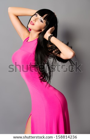 Fashion photo of a beautiful model in long summer dress. - stock photo