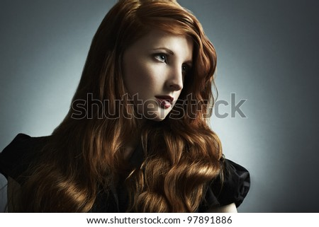 Fashion photo of a beautiful young red-haired woman. Close-up portrait - stock photo