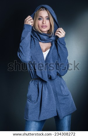 Fashion photo of attractive blonde woman looking at camera. - stock photo