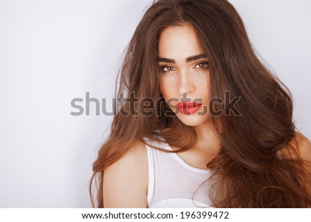 Fashion photo of attractive brunette with long hair. Studio shot. - stock photo