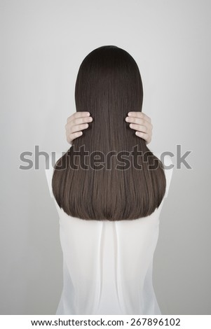 fashion photo of beautiful healthy long hair.back of brunette girl - stock photo