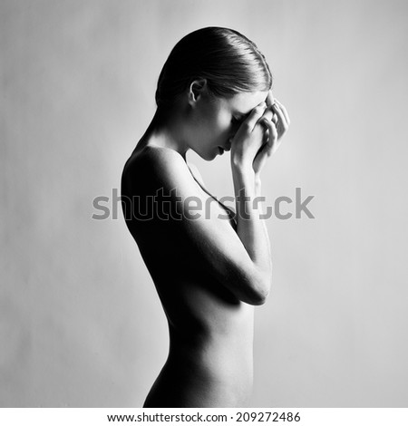 Fashion photo of beautiful nude woman. Black and white photography - stock photo