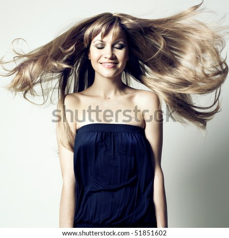 Fashion photo of beautiful woman with magnificent hair - stock photo