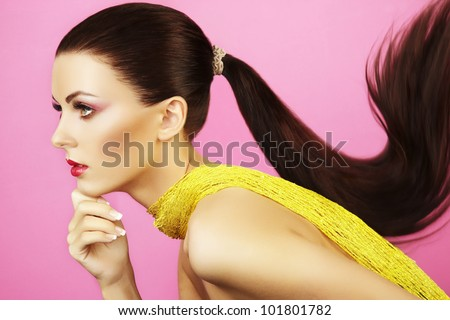 Fashion photo of  beautiful woman with  ponytail. Beauty woman on pink background - stock photo
