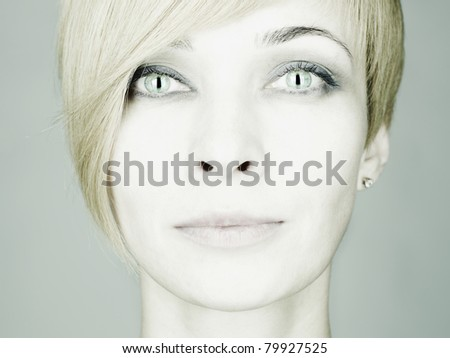 Fashion photo of beautiful young woman with cat eyes - stock photo