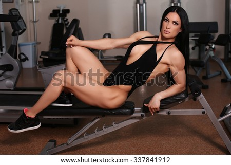 fashion photo of body fitness silver medalist of world ladies cup posing in gym