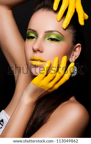 fashion photo of sexy brunette woman with yellow gloves