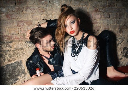 Fashion photo of sexy elegant couple in the tender passion - stock photo