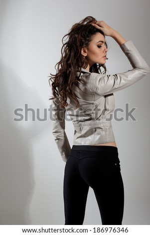 Fashion photo of young magnificent woman.A photo of beautiful girl is in fashion style posing in studio.