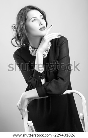 Fashion photo of young magnificent woman. Girl posing. Studio photo. black white