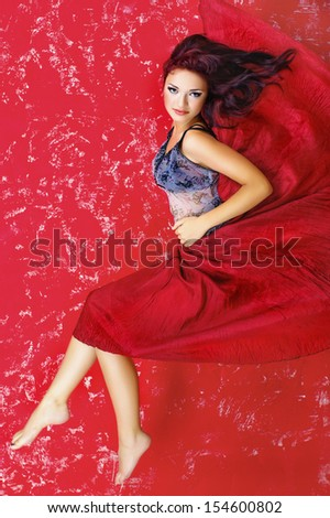 Fashion photo of young magnificent woman  over red
