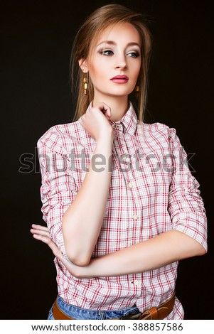 Fashion photo of young model woman on black background. Girl posing. Studio photo.
