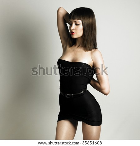 Fashion photo of young slender woman in fashionable swimsuit - stock photo