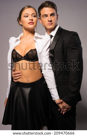 Fashion Photo Shoot. Middle Age Partners in Sexy Black and White, Isolated on Gray. - stock photo