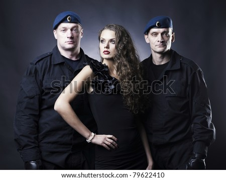 Fashion photography of a beautiful young lady and her bodyguard - stock photo