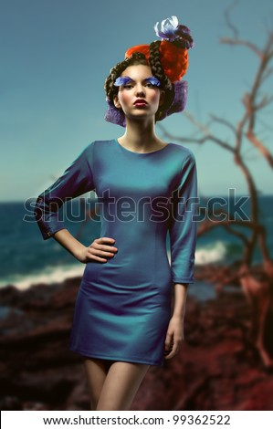fashion picture of young woman with creative and colorful hairstyle - stock photo