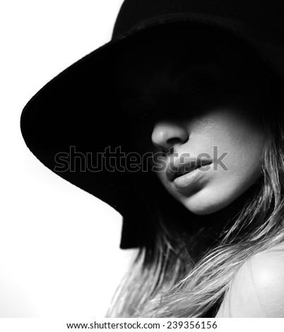 Fashion portrait dramatic dark deep shadow - stock photo