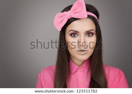 Fashion portrait of a beautiful brunette in pink