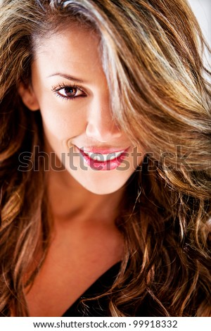 Fashion portrait of a beautiful female smiling