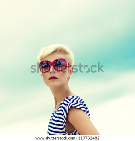 fashion portrait of a beautiful girl in the sky