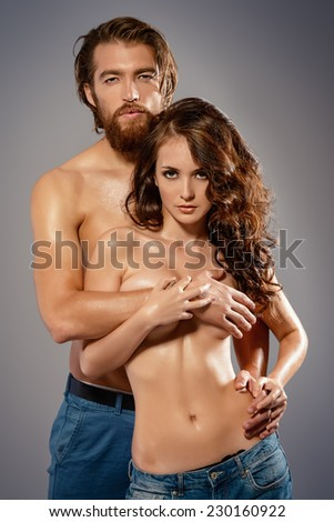 Fashion portrait of a beautiful tender lovers. Denim style. - stock photo