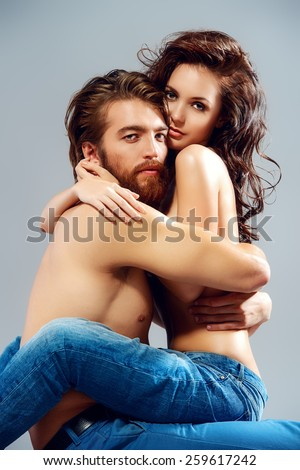 Fashion portrait of a beautiful tender lovers. Denim style.