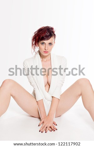 Fashion portrait of a beautiful woman in white pullover, in front of white background - stock photo