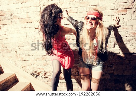 Fashion portrait of a beautiful young sexy womans  wearing sunglasses