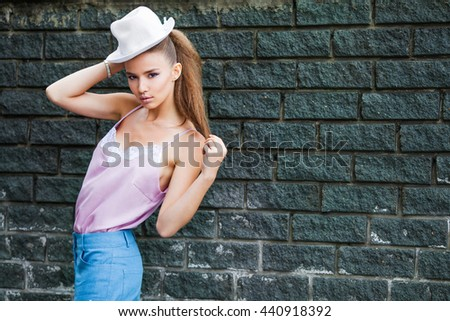 Fashion portrait of a girl in a hat - stock photo
