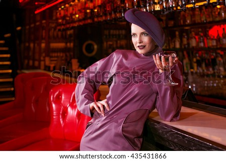Fashion portrait of a girl in a stylish hat - stock photo