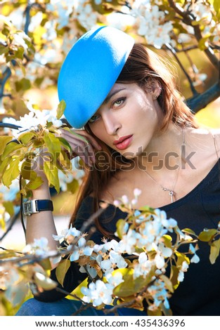 Fashion portrait of a girl in a stylish hat