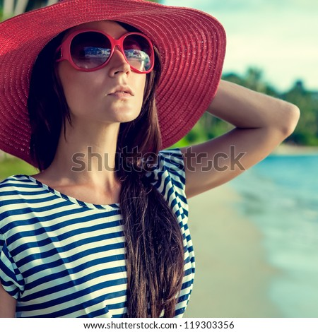 fashion portrait of a girl on vacation - stock photo