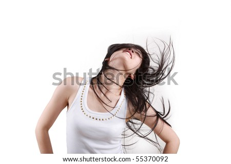 Fashion portrait of a girl with hair lightly fluttering in the wind