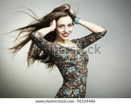 Fashion portrait of a happy young woman smiling