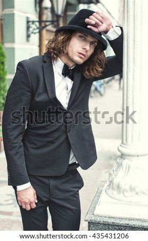 Fashion portrait of a man in a stylish hat - stock photo
