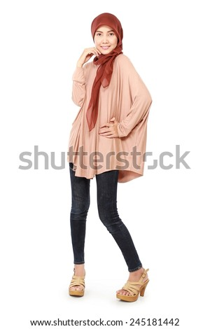 Fashion portrait of a pretty happy young Muslim women to wear the hijab, isolated on white background