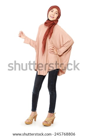 Fashion portrait of a pretty happy young Muslim women to wear the hijab, isolated on white background - stock photo