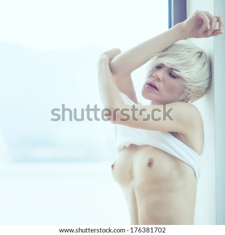 fashion portrait of a sensual girl in the room - stock photo