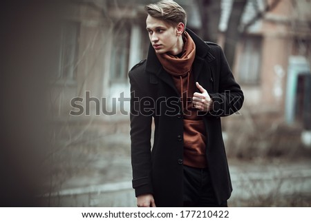 fashion portrait of a stylish man posing outside, autumn time - stock photo