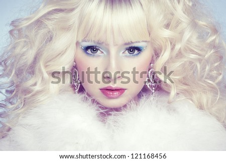 Fashion portrait of a young beautiful blonde woman. Winter style. Winter Makeup