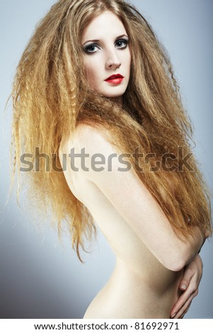 Fashion portrait of a young beautiful redhead woman
