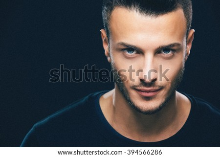 Fashion portrait of an attractive young man in the studio, close up. Beauty concept. Added retro filter and grain. - stock photo