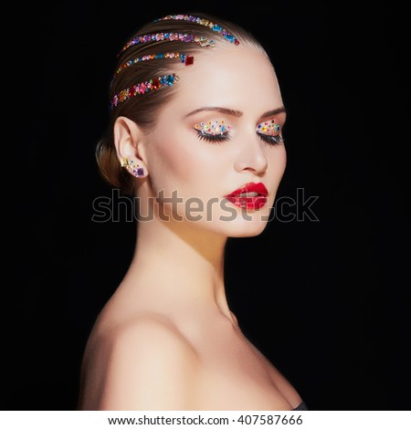 fashion portrait of beautiful blond young woman with make-up.colorful beauty girl