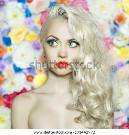 Fashion portrait of beautiful blonde on flower background - stock photo