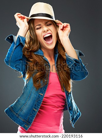 fashion portrait of beautiful girl in youth style. smiling joyful woman studio portrait . gray background isolated . - stock photo