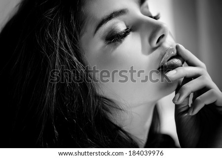 Fashion Portrait Of Beautiful Girl. Vogue Style Woman. Black and White Photo. Hairstyle. Sexy Lips And Polish Nails. - stock photo