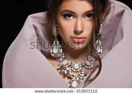 Fashion portrait of beautiful girl with dark hair in luxurious sequin dress  - stock photo