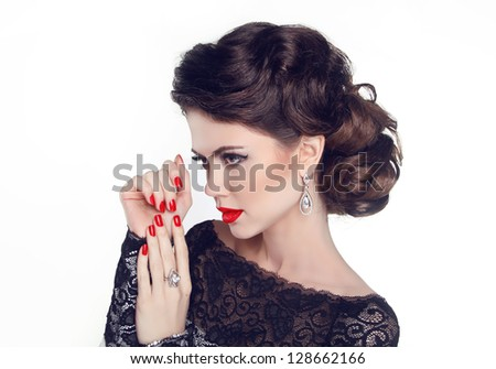 Fashion Portrait Of Beautiful Girl with red nails and lips. Vogue Style Woman. Hairstyle - stock photo