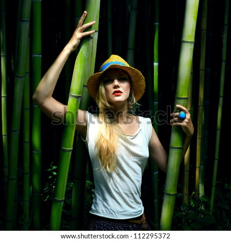 Fashion portrait of beautiful woman. Bamboo forest.