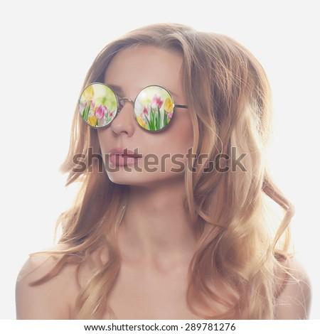 fashion portrait of beautiful woman in sunglasses.beauty blond girl. Summer flowers - stock photo